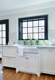 white kitchen cabinets with window trim 3 reasons to paint window trim black emily a clark