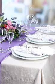 dining table setting with lavender flowers on table on bright