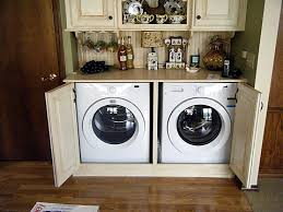 washer and dryer cabinets build a bar or kitchen counters to conceal laundry except we have a
