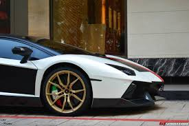 gold and white lamborghini novitec torado from singapore boasts impressive wrap