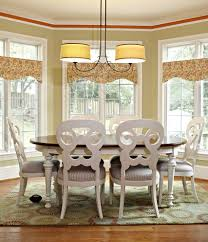 luxury window treatments dining room traditional with gold curtain