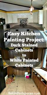 easy painting project for your kitchen cabinets dark cabinets to