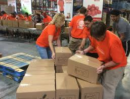 u haul team members pack food for the hungry at st marys food