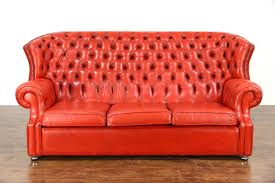 wingback couch sold red tufted leather vintage scandinavian traditional