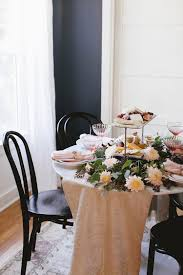 a whimsical blush thanksgiving tablescape small space entertaining