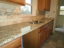 small kitchen design using white stone tile kitchen backsplash