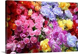 silk flowers a bright and colorful array of silk flowers at an outdoor flea