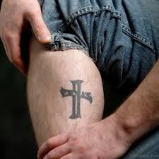 55 antic cross tattoos for leg