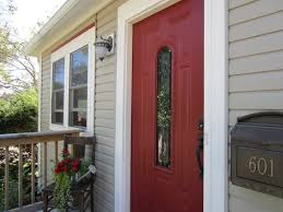 sherwin williams stolen kiss red front door patio garage lawn