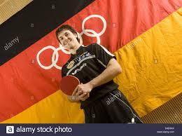 German Flag Shirt German Table Tennis Pro Timo Boll Poses Next To A German Flag
