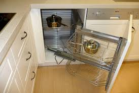 white wooden corner kitchen cabinet with rolling out chrome metal