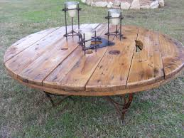 coffee table made from repurposed cable spool and metal base