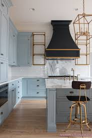 classic vintage modern kitchen blue gray cabinets inset shaker classic vintage modern kitchen blue gray cabinets inset shaker black gold vent hood antique brass faucet white subway backsplash tile gold open shelves 8 of