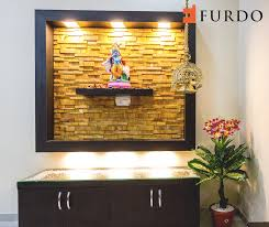 stone cladded foyer with hindu idol by furdo puja rooms mandir