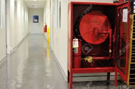 american fire hose cabinet fire hose cabinet installed in the building stock photo picture and