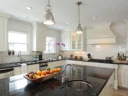 ivory kitchen faucet black granite countertops transitional kitchen