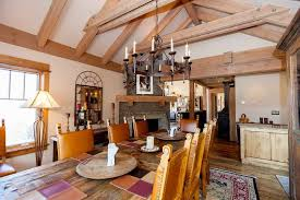 rustic dining room with exposed beam u0026 chandelier zillow digs