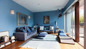 living room blue accent wall brown striped wood wall treatment