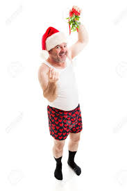 mistletoe hat middle aged in his and a santa hat holding