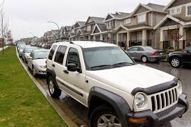 wrecked jeep liberty surrey cracks down on illegal suites in clayton surrey now leader