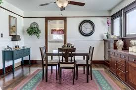craftsman dining room with ceiling fan u0026 carpet in colton ca