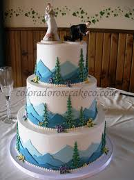 a tiered cake decorated with mountain scenery i love the cake