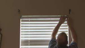 anderson windows with blinds between the glass business for