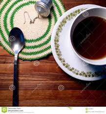 hot tea on butcher block table with vintage doily and spoon stock hot tea on butcher block table with vintage doily and spoon