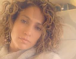 natural styles that you can wear in the winter wearing hair extensions with curly hair great lengths