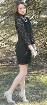 wedding guest wear black lace dress with white fur coat