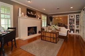 Country Family Room Ideas With White Brick Fireplace And Wooden - Country family room ideas