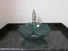 unique clear glass wavy vessel sink for classy bathroom look