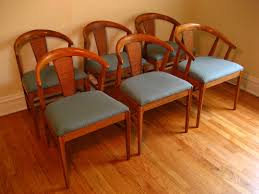 cane back dining room chairs with trendy blue and brown theme