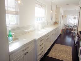 How To Make A Galley Kitchen Look Larger The Eat In Galley Kitchen Features Dark Wood Floors Cabinets And