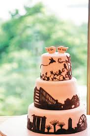 a travel themed wedding with purple accents and lush flowers her