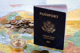 map of usa with compass usa passport compass and foreign coins sit on a map of europe