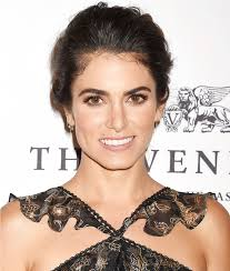 hairstyles for giving birth nikki reed does acroyoga in a sports bra instyle com