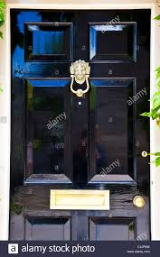 a shiny high gloss black painted front door with highly polished