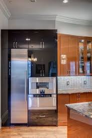 Art Deco Kitchen Design by Custom Cabinet Hood Elmwood Cabinetry Wood Print U0026 Black Slab
