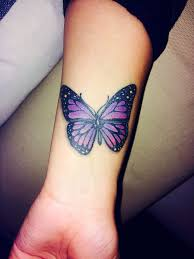 purple and black butterfly on wrist