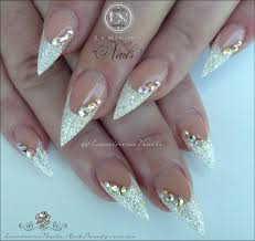 luminous nails white christmas acrylic nails with a touch of red