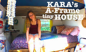 woman builds and lives in her own tiny house a frame cabin