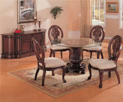 awesome pedestal round glass dining table with large rug and