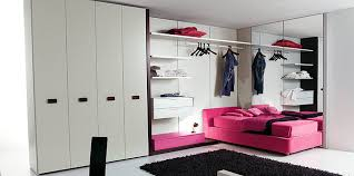 purple wooden bed on the floor and white wall theme connected by