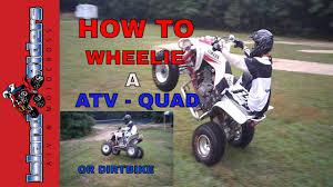 motocross bikes for beginners how to wheelie a atv quad dirt bike 4 wheeler for