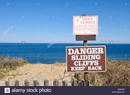 erosion at cape cod national seashore warning sign on cliff at