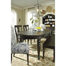 solid wood oval dining room extension table by signature design by
