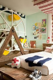 kids themed bedrooms bedroom white bed brown wooden floor fairground themed kids room