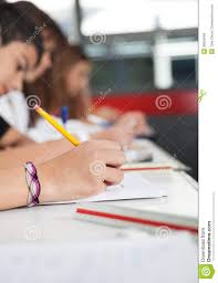 Desks For High School Students by High School Students Writing At Desk Royalty Free Stock Photos