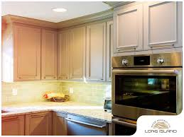 painting wood stained kitchen cabinets how to choose between painted and stained kitchen cabinets